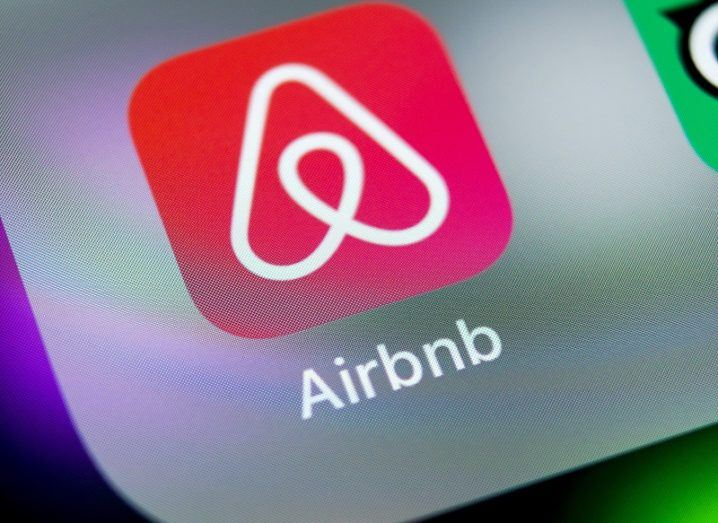 The Airbnb app logo on an iPhone.