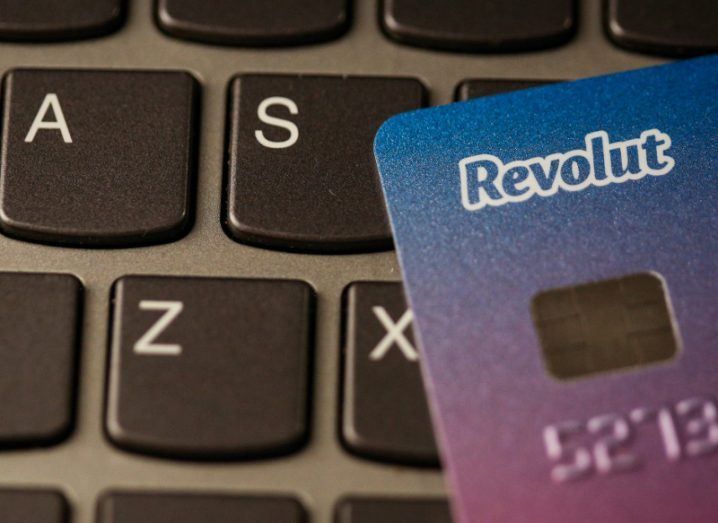Blue and purple Revolut card on a laptop keyboard.
