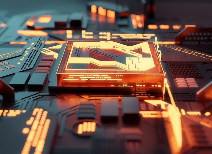 Concept image of a quantum computer chip glowing an orange colour.