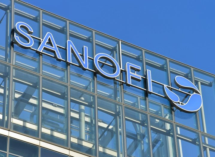 The Sanofi logo on the side of a glass building.