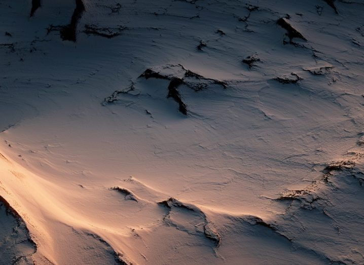 Desolate Antarctic wilderness at dusk seen from the air.