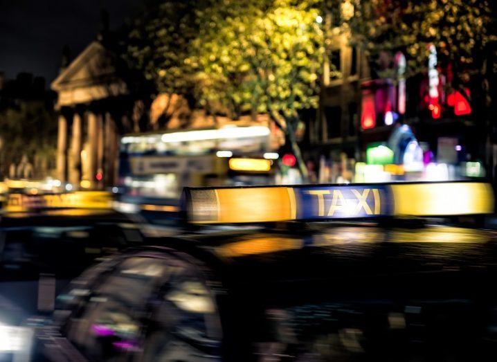 Dublin taxis on O'Connell Street at night.