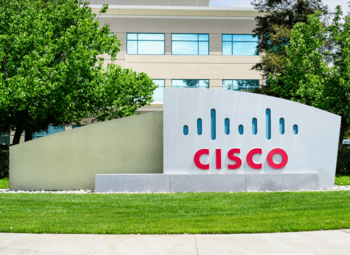 The Cisco logo on a large, stone plaque outside of an office building.