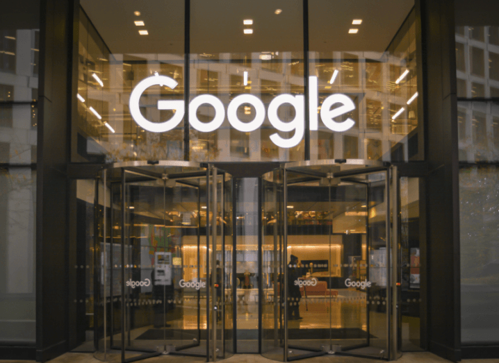The Google logo displayed in the front of an office building.
