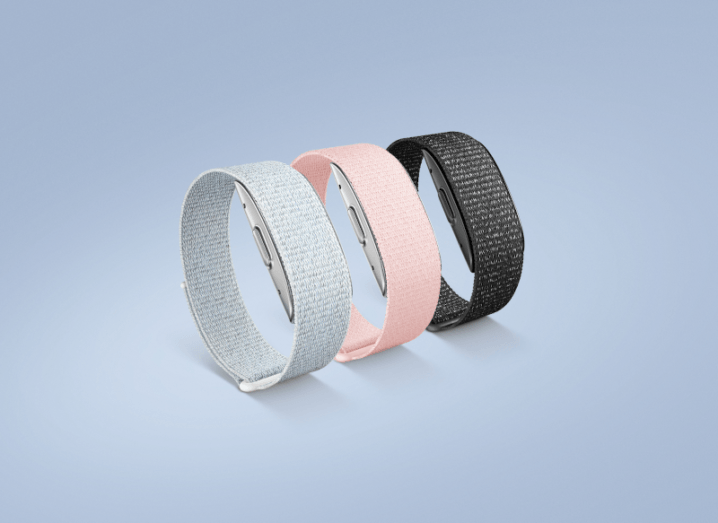 Three Halo fitness bands in silver, pink and black.