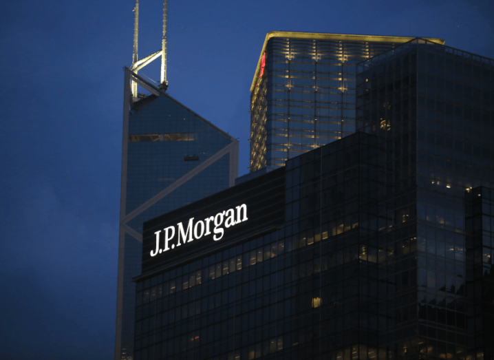 A large glass building with the JP Morgan logo on the front of it.