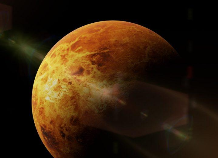 3D render of the planet Venus, half in darkness.