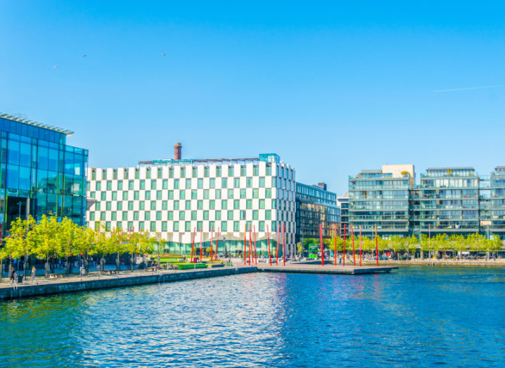View of Grand Canal Dock on a sunny day showing a cityscape of modern office buildings.