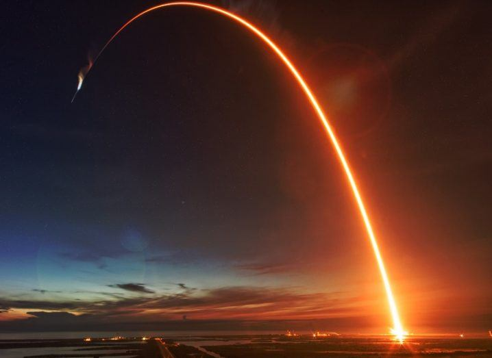 Timelapse image of a rocket trail after take-off at night.