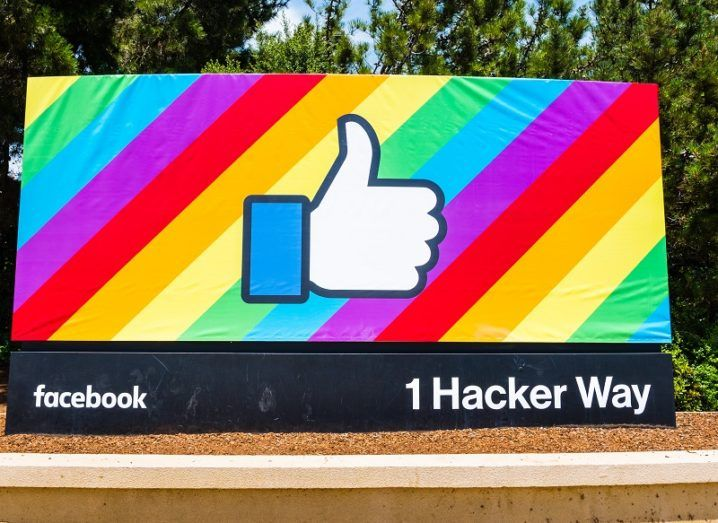 Facebook office sign with the thumbs-up logo against a multicoloured background.