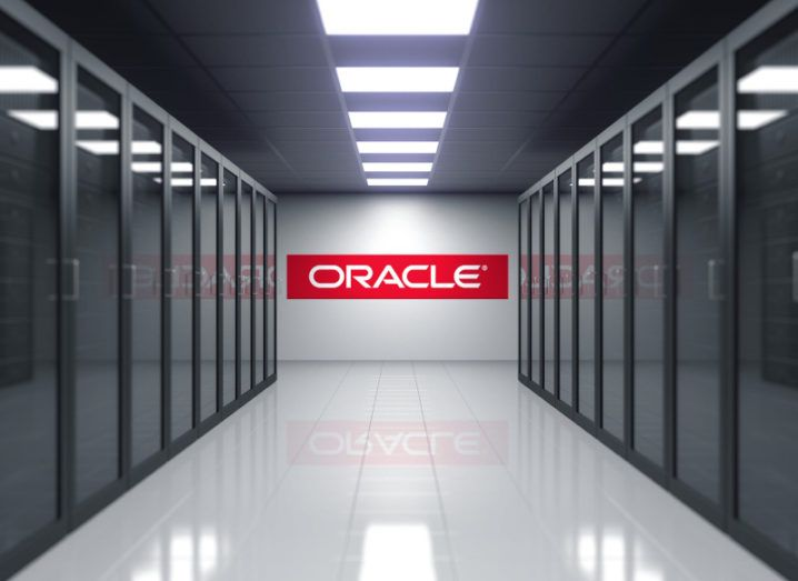 3D rendering of a server room with the Oracle logo in red across the back wall.