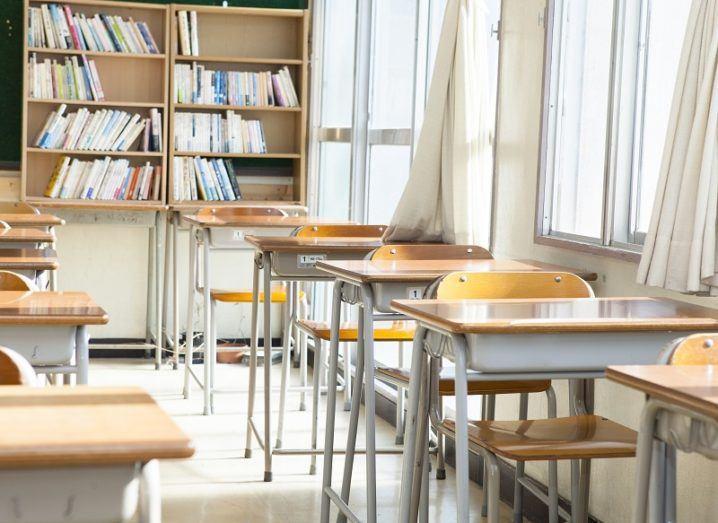 Empty school desks in a classroom.