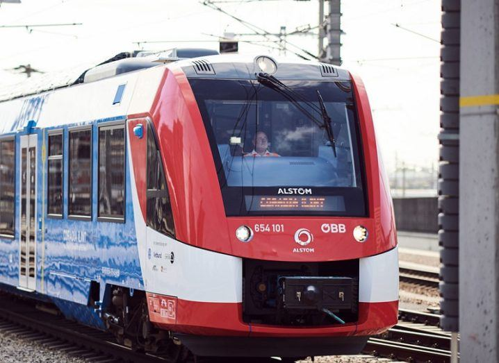 The Alstom Coradia iLint hydrogen-powered train coloured red and blue.