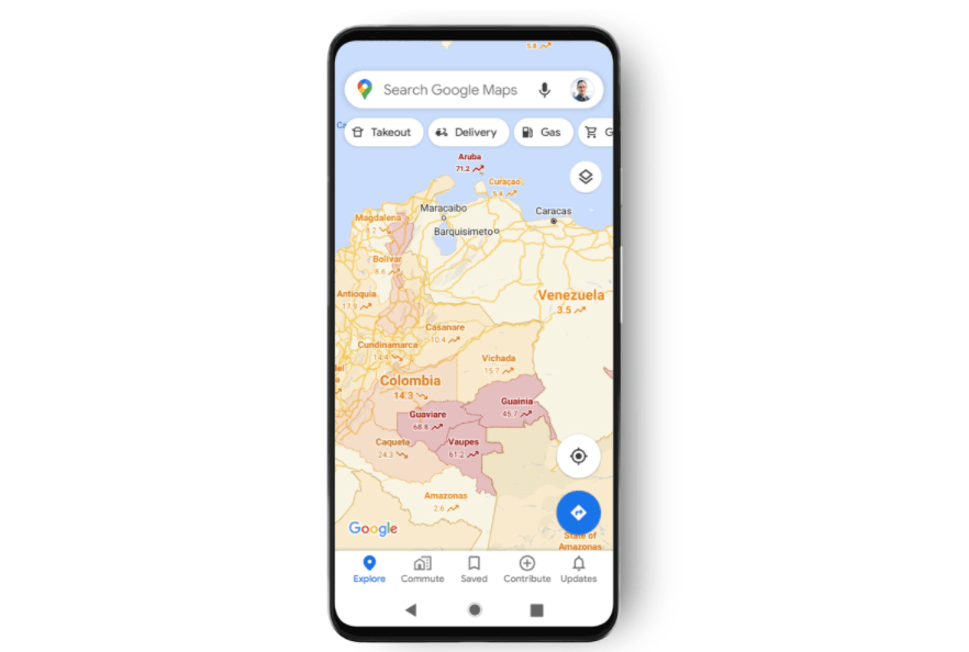 A phone with the Google Maps app open. It is showing a map of different regions in South America. Most are coloured orange, but some regions are coloured in red to indicate a higher prevalence of Covid-19.