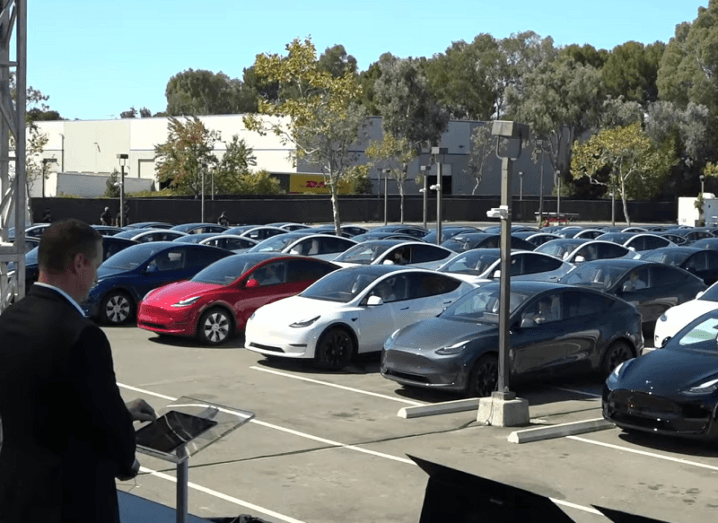Rows of Tesla cars lined up in a car park at the Battery Day event.