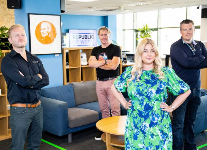 Four team members from Republic of Work and Teamwork are standing in a colourful office space.