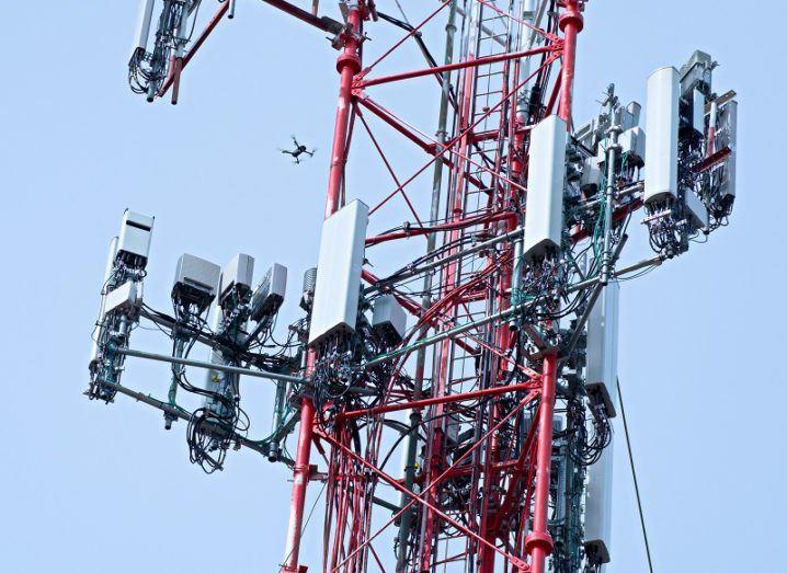 5G antenna array against a blue sky background.