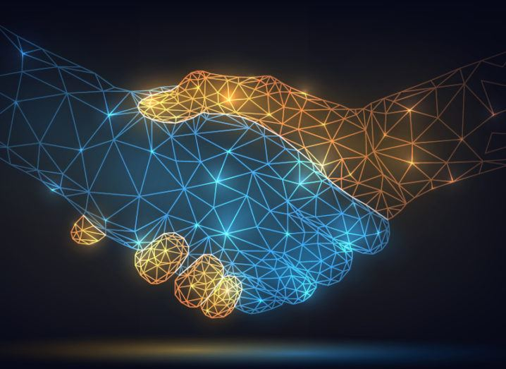 Illustration of a handshake made up of many connected data points.