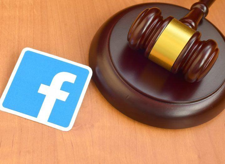The Facebook logo beside a wooden gavel.