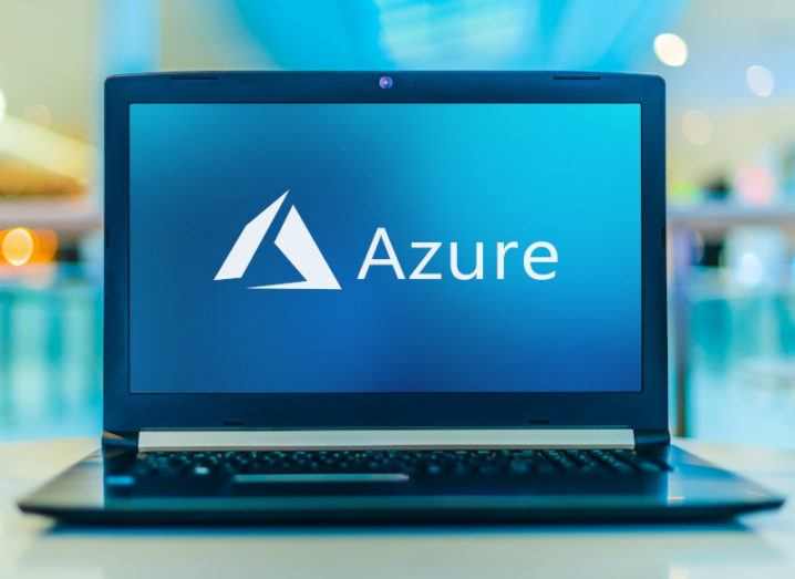 A laptop computer displaying the Microsoft Azure logo on its screen.
