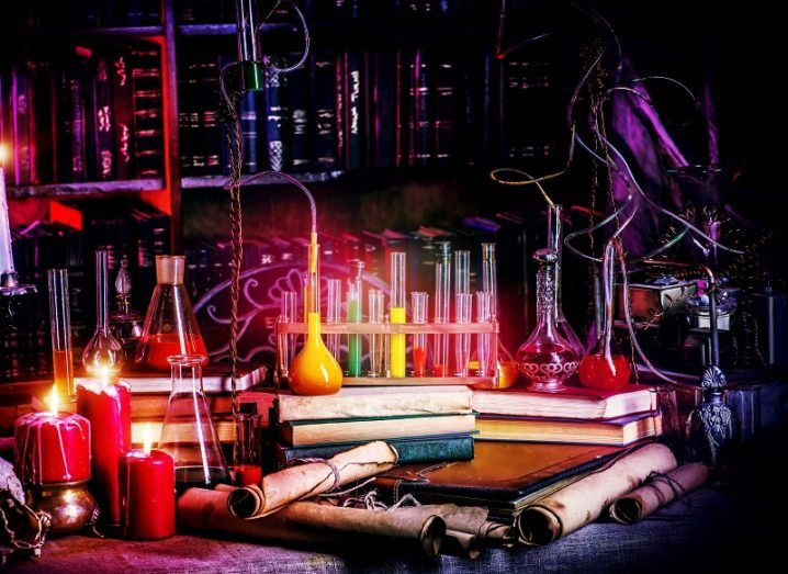 Beakers and lab equipment shrouded in red light and darkness.
