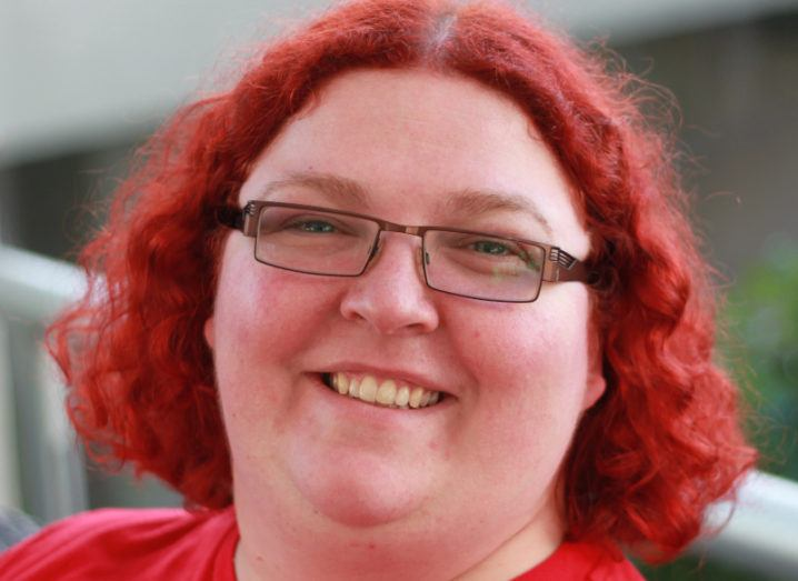 A close-up image of Meri Williams, who has bright red hair and glasses.