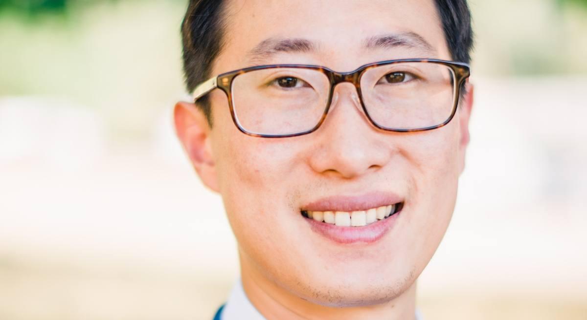 Richard Wang of Coding Dojo is smiling into the camera.