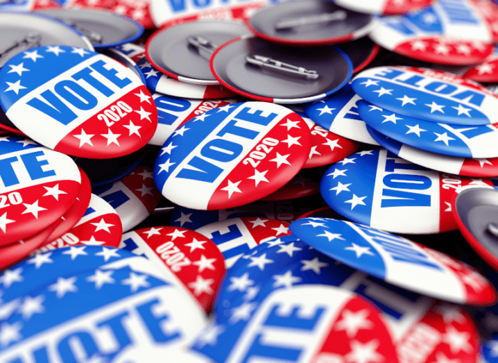 """Badges with the US flag and the word """"Vote"""" printed on the front in a pile."""