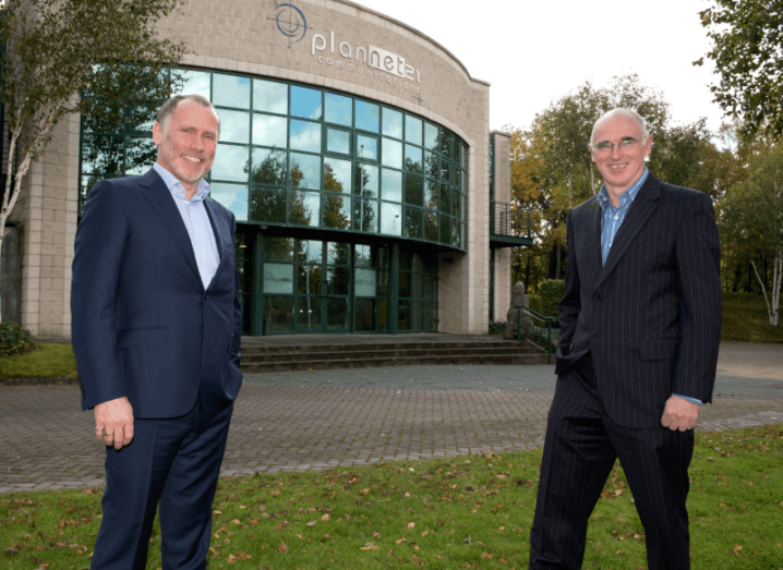 Two men standing outside of the PlanNet21 office in Dublin.