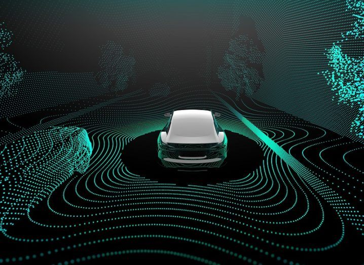 3D concept of an autonomous car driving down a road surrounded by sensor readings coloured green.