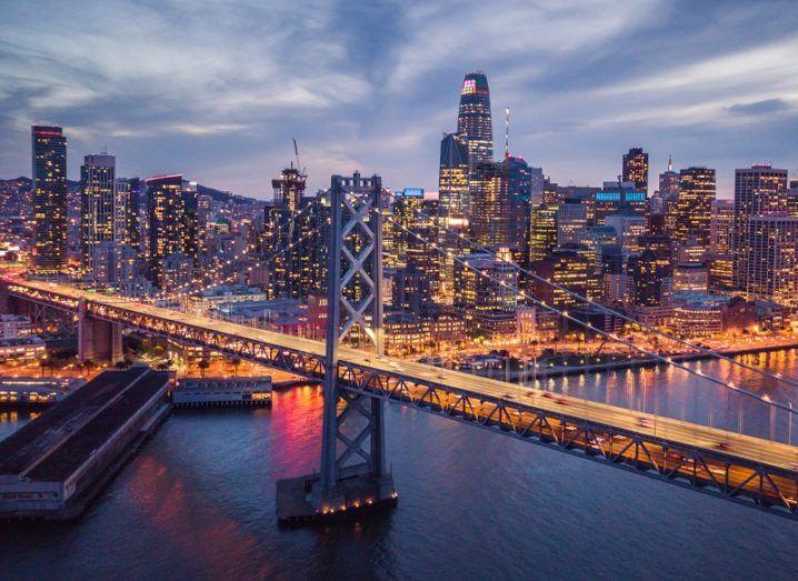 Aerial view of San Francisco at the Bay Bridge at night.