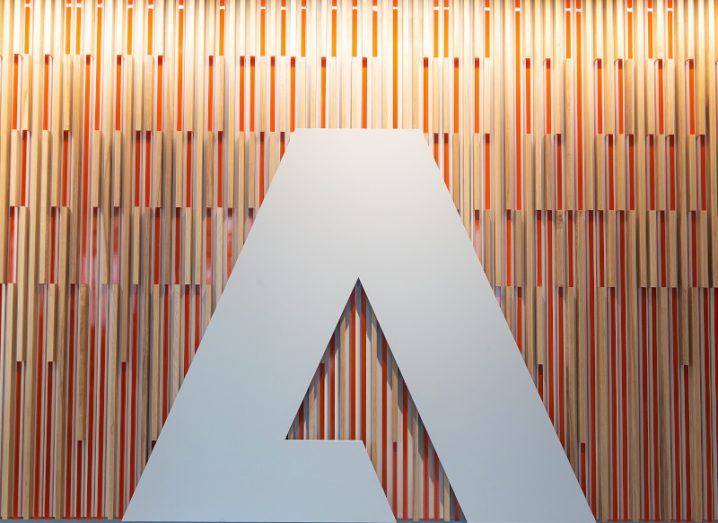The Adobe logo on a feature wall in an office building in Seattle, Washington.