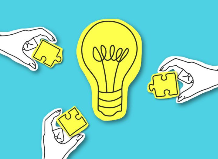 Illustration of hands reaching towards a yellow lightbulb with yellow jigsaw pieces.