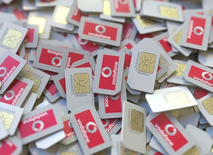 Pile of SIM cards with Vodafone logos on them.