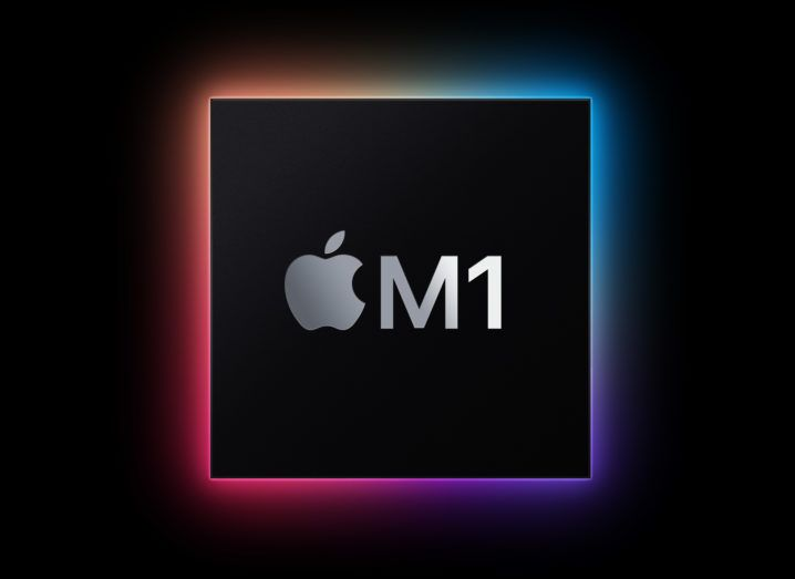 A black square with the Apple logo and M1 on it, lit up in an array of colours against a black background.