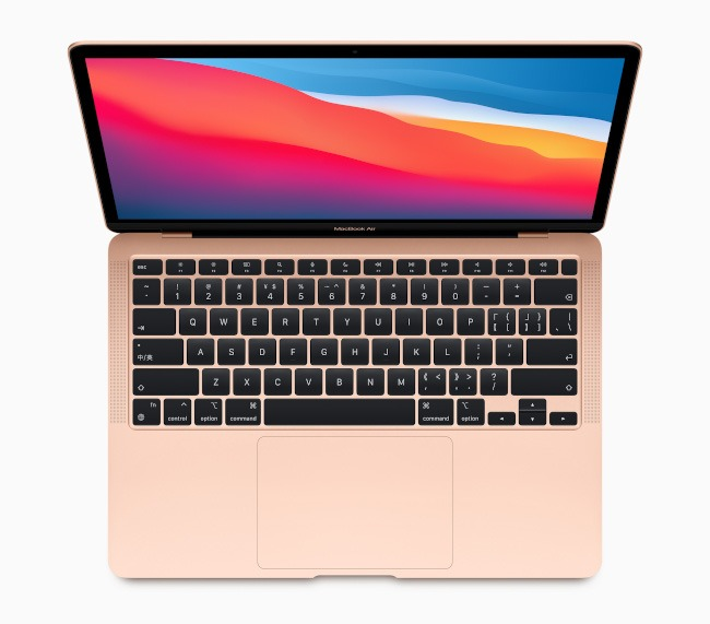 A rose-coloured MacBook Air opened to display the full keyboard.