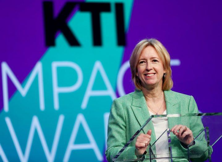Dr Alison Campbell smiling at a podium in front of a KTI Impact Awards logo.