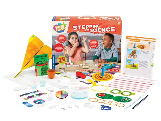 A kids' science experiment box with a lot of accompanying items spread out on display.