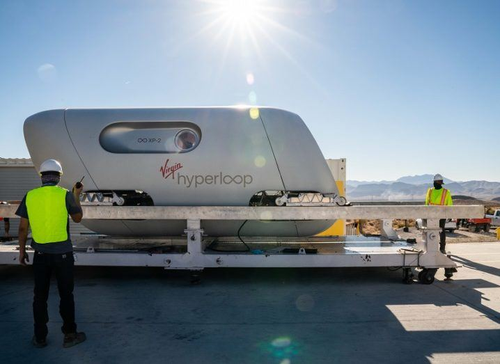 The XP-2 Virgin Hyperloop pod being prepared for its test run against a sun-filled sky.