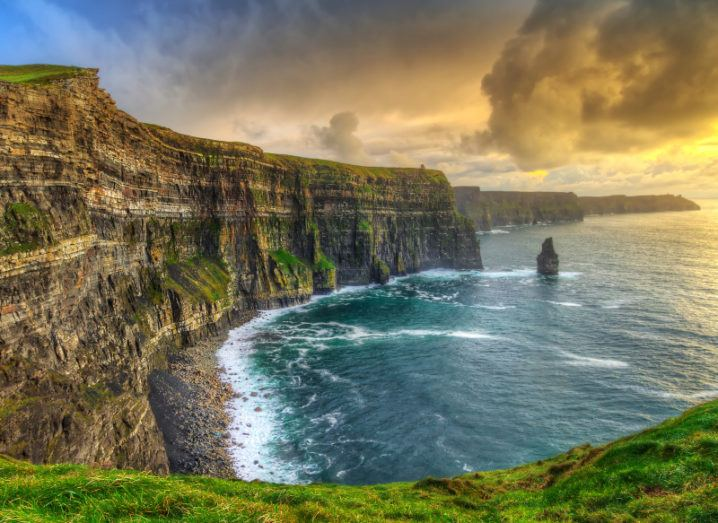 A beautiful landscape shot of the Cliffs of Moher at sunset.