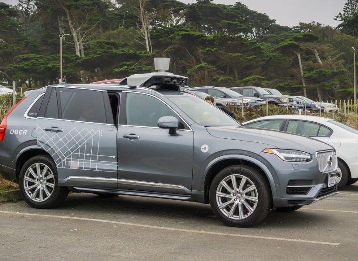 An Uber autonomous car coloured grey in a car park.
