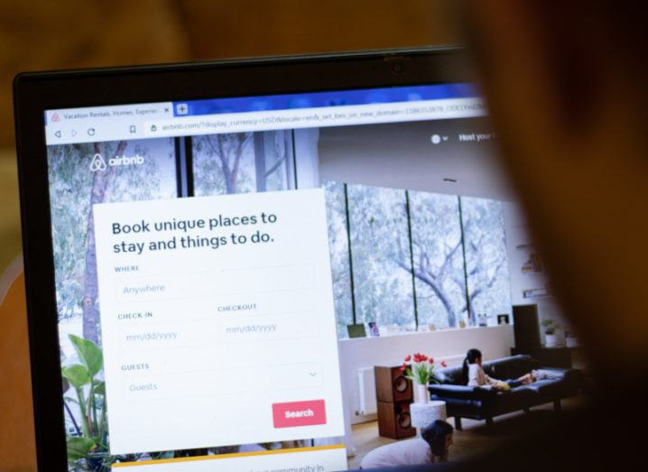 A person using the Airbnb website on a laptop.