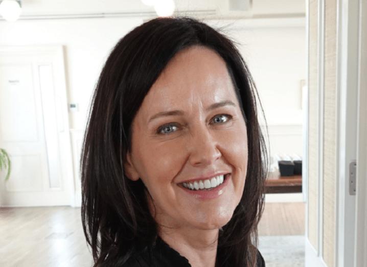 Headshot of Andrea Reynolds smiling.