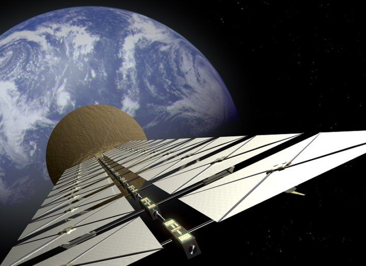 Artist's impression of a solar space station satellite above Earth.