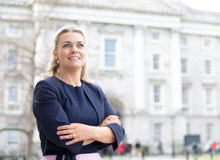 Nessa McEniff of Learnovate stands in the front square of Trinity College Dublin.