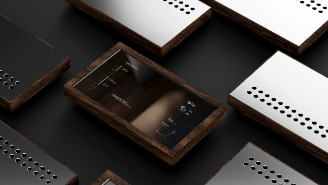 Concept image of Mirr, a reflective touchscreen set in a wooden frame displaying information such as the weather.
