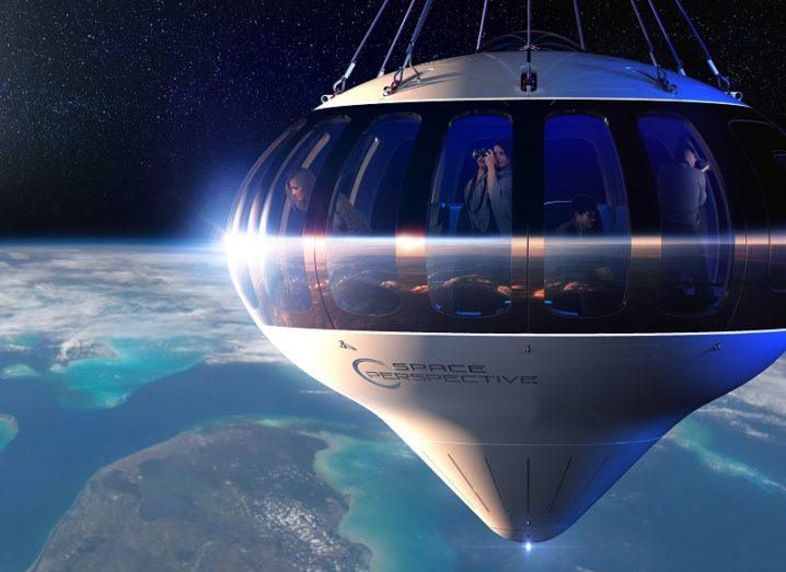 3D render of the Spaceship Neptune balloon and capsule filled with tourists overlooking the Earth.