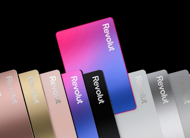 A line of differently coloured Revolut cards.
