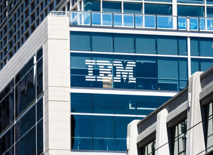 Photograph of IBM branding on company headquarters in San Francisco against a bright blue sky.