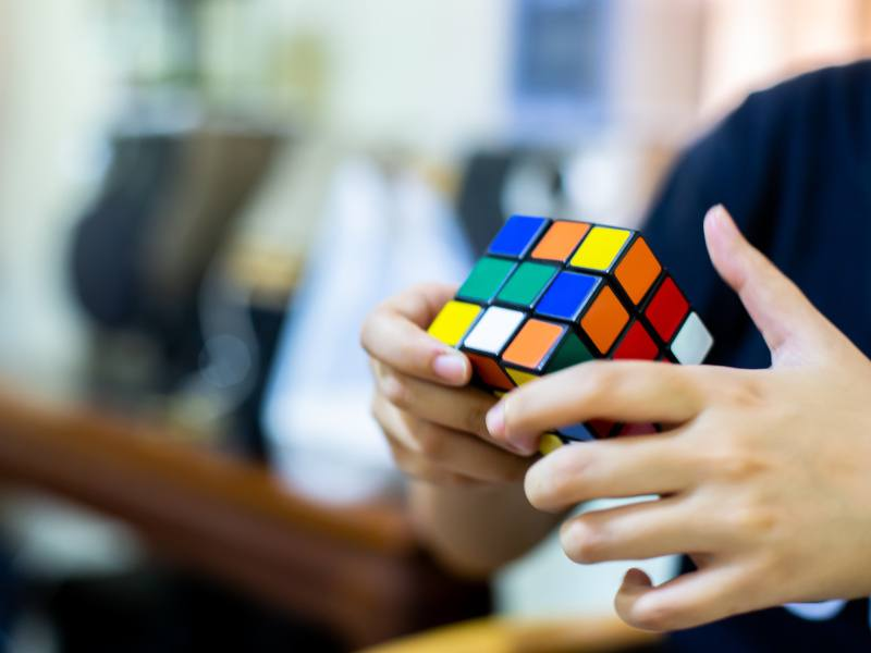 Why it's important that AI learns to teach people to solve a Rubik's cube